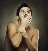 Afraid male victim human with hand covering his mouth — Stock Photo