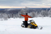 Athlete on a snowmobile — Stock Photo