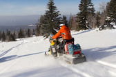 Athletes on a snowmobile. — Stock Photo