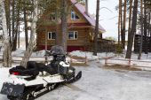 Snowmobile at home — Stock Photo