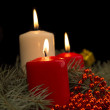 Three burning Christmas candles on the background of fir-tree br — Stock Photo #52719391