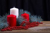Three  Christmas candles on the background of fir-tree branches — Stok fotoğraf