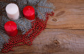 Christmas candles on the old wooden background and fir-tree bran — Stok fotoğraf