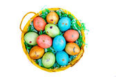 Multicolored Easter eggs in a basket — Stock Photo