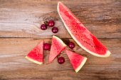 Slices of watermelon on old wooden background — Stock Photo