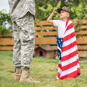 Son salutes his father — Stockfoto