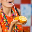 Fashion woman drinking orange juice smiling — Stock Photo #52157071