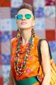 Stylish woman wearing sunglasses and accessories — Stock Photo