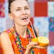 Fashion woman drinking orange juice smiling — Stock Photo #52397423