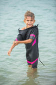 Cute little boy in wetsuit after diving in sea — Stock Photo