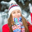 Beautiful young girl playing with snow — Stock Photo #53589629