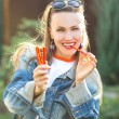 Candy woman eat sweets — Stock Photo #53721413