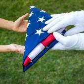 Hands hold american flag — Stock Photo