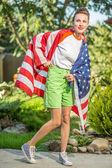 Beautiful woman with national usa flag — Stock Photo