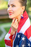 Woman with american flag — Stock Photo