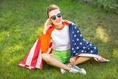 Beautiful young pretty woman with american flag — Stock Photo