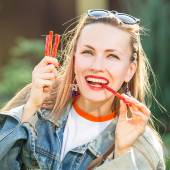 Candy woman eat sweets — Stock Photo