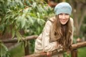 Beautiful autumn woman in autumn park — Stock Photo