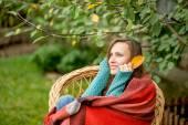 Beautiful girl in autumn garden — Stock Photo