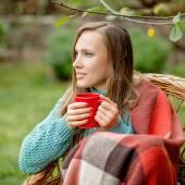In autumn garden woman — Stock Photo
