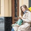 Young woman using smart phone — Stock Photo #55127751
