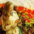 Autumn woman using mobile phone — Stock Photo #55165481