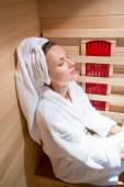 Beautiful woman relaxing a sauna — Stock Photo