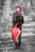 Autumn woman with red umbrella — Foto de Stock