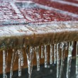 Icicles hanging down from a roof — Stock Photo #56322139