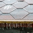 Icicles hanging down from a roof — Stock Photo #56322217