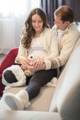 Happy  young pregnant couple hugging and smile — Stockfoto