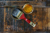 Brush and oil  varnish paint — Stock Photo
