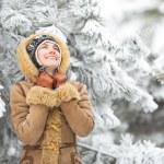Beautiful winter woman have fun in winter park — Stock Photo #58617999