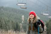 Woman, no snow and empty ski lifts — Stock Photo