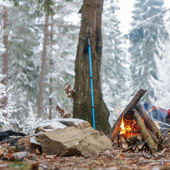 Campfire in winter forest — Stock Photo