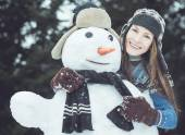 Portrait of funny winter woman with snowman — Stock Photo