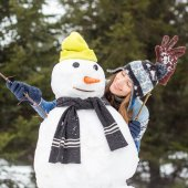 Beautiful funny winter woman with snowman — Foto de Stock