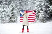 Patriotic young woman with the American flag — Стоковое фото
