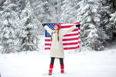 Patriotic young woman with the American flag — Photo
