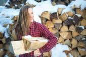 Young woman posing with wooden logs for bonfire — Stock Photo