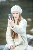 Winter woman using smart phone — Stock Photo