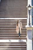 Woman on staircase — Stock Photo