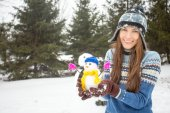Funny woman with snowman — Stock Photo