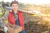 Female farmer working in garden — Stock Photo