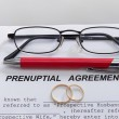 Prenuptial Agreement with wedding rings — Stock Photo #56246469