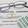 Prenuptial Agreement with wedding rings — Stock Photo #56246613