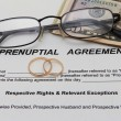 Prenuptial Agreement with wedding rings — Stock Photo #56246769