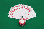 Cards on green casino table — Stock Photo