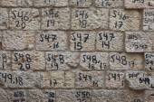 Old Jerusalem stones with numbers — Stock Photo