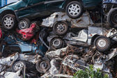 Scrap yard with crushed cars and blue sky — Stock Photo